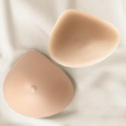 Prothèse seins silicone asymétrique, mamelons en option